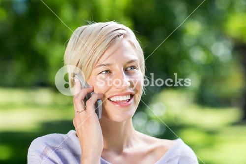 Happy blonde on the phone