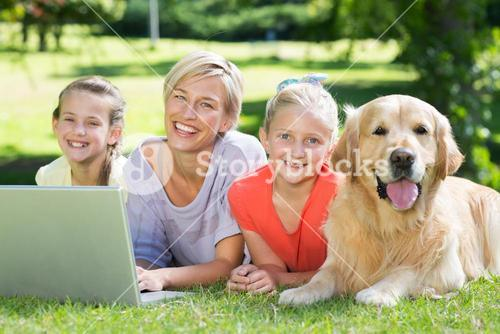 Happy family and their dog smiling at the camera