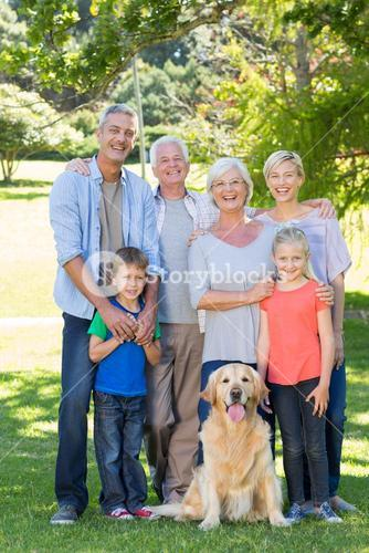 Happy family with their dog smiling to camera