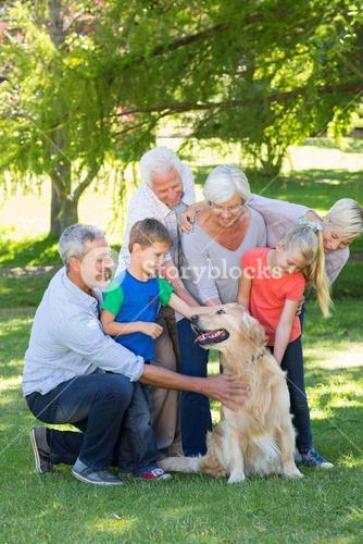 Happy family petting their dog