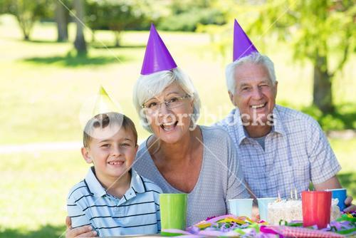 Happy grandparents with their grandson