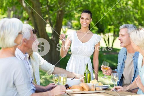 Pretty brunette toasting with her family