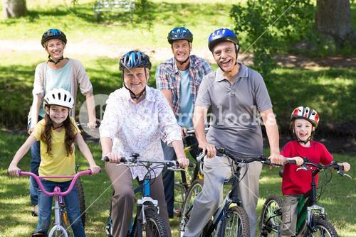 Happy family on their bike at the park