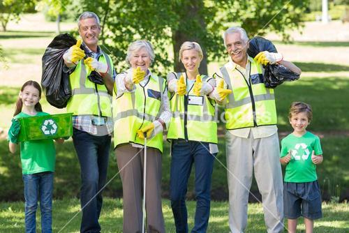 Happy family collecting rubbish with thumbs up