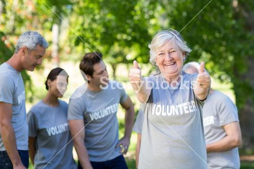 Happy volunteer grandmother with thumbs up