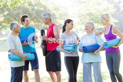 Happy athletic group talking