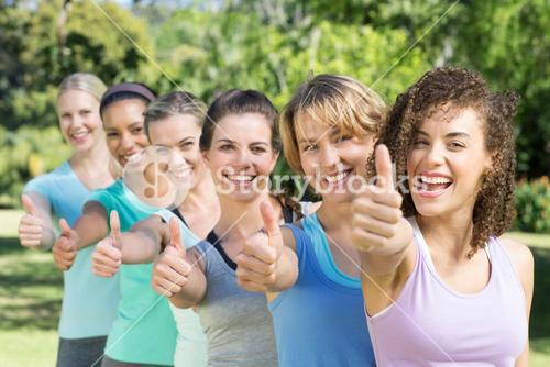 Fitness group smiling at camera