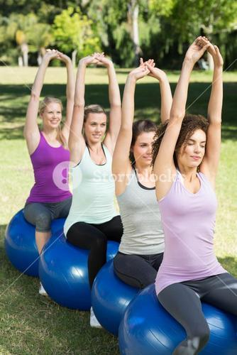 Fitness group sitting on exercise balls