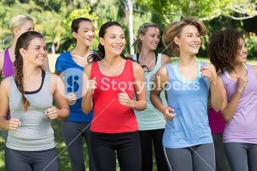 Fitness group jogging in the park
