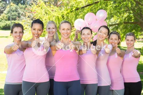 Smiling women in pink for breast cancer awareness