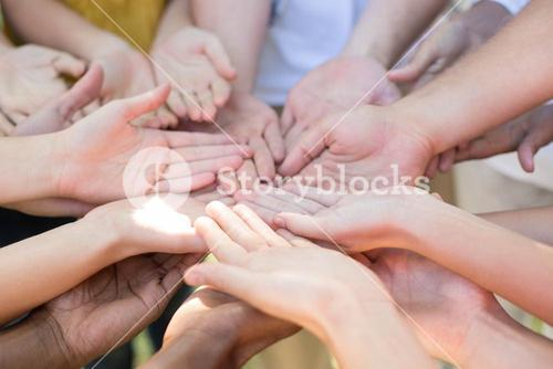 Friends putting their hands together