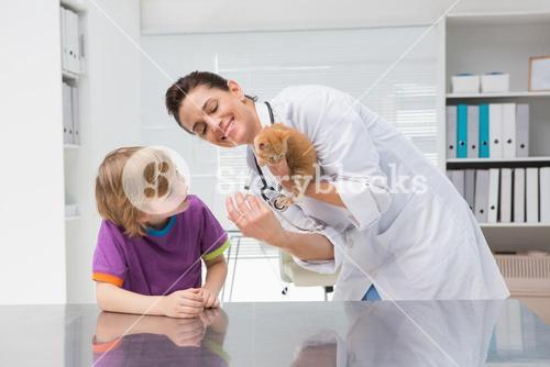 Veterinarian doing injection at a cat with its owner