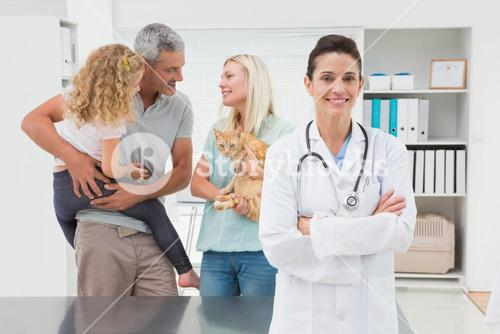 Smiling veterinarian looking at camera
