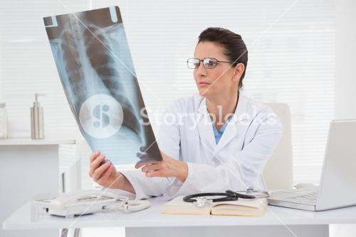 Doctor looking at scans