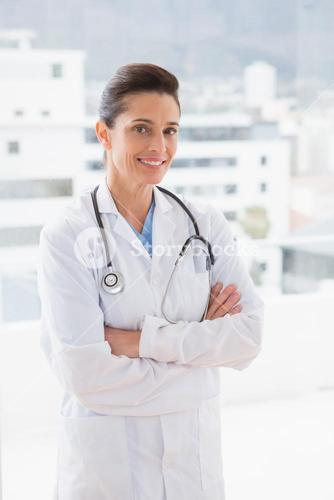 Doctor with stethoscope and arms crossed