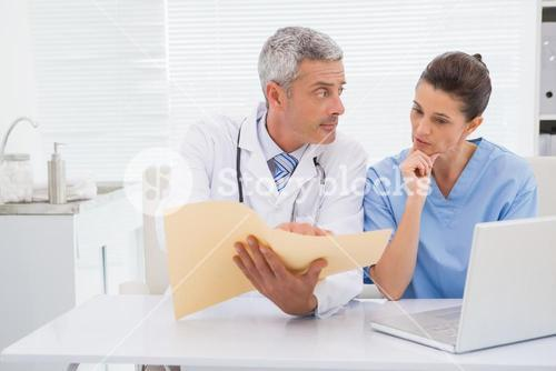 Doctors looking at files