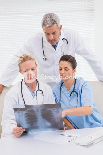Doctors looking at scans
