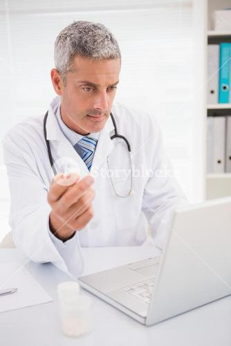 Doctor typing on keyboard the prescriptions