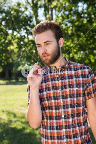 Hipster smoking an electronic cigarette