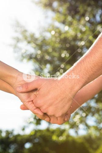 Couple holding hands in park