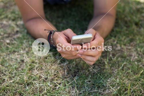 Man using phone in park