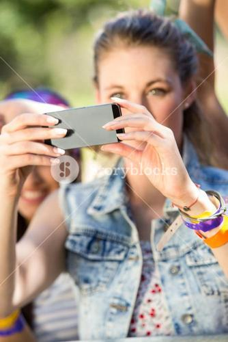 Excited music fan taking photo