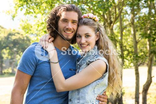 Cute couple smiling at camera