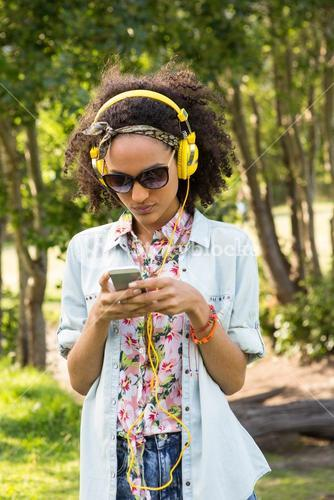 Pretty hipster using her smartphone