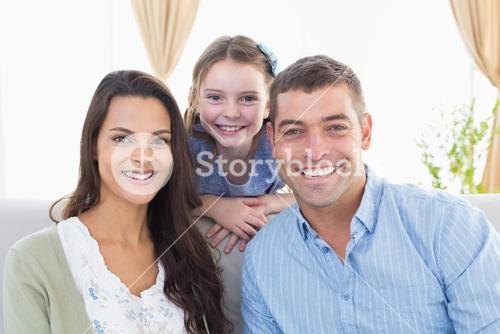 Happy parents with daughter at home
