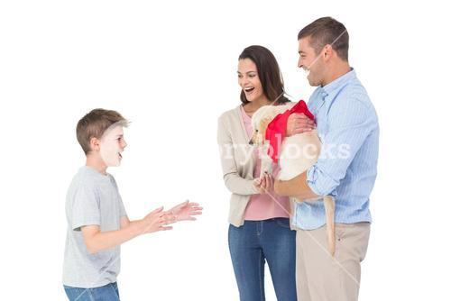 Parents gifting puppy to boy