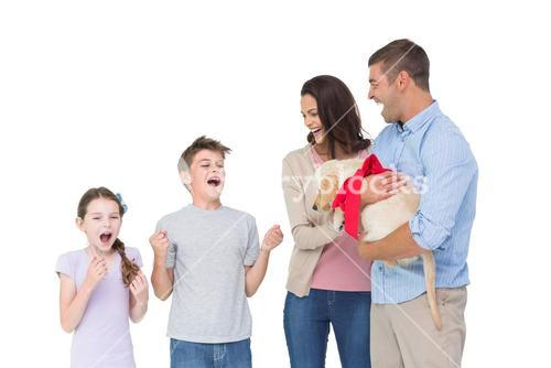 Parents gifting puppy to children
