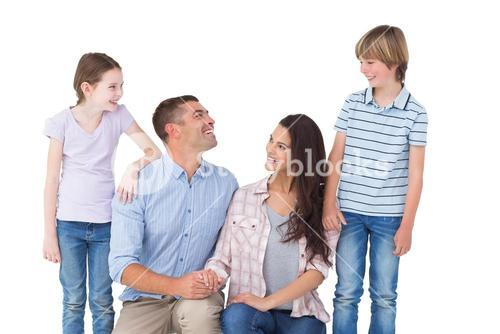 Family smiling while looking at each other