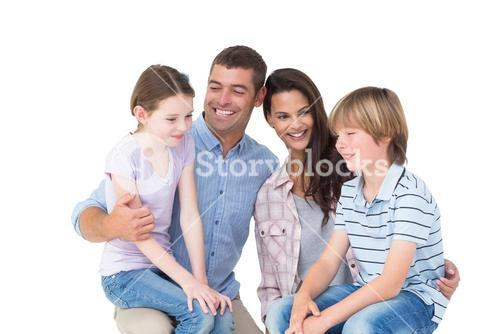 Children sitting on parents laps over white background