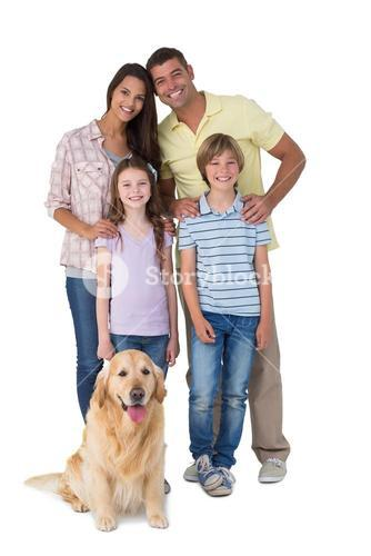 Happy family standing with dog