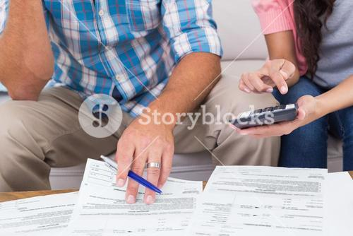 Couple calculating finances at home