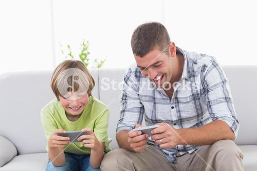 Father and son playing games on mobile phone