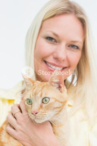 Happy woman holding cat on white background