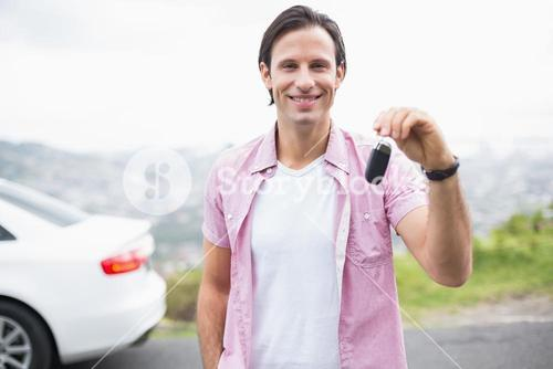 Man smiling and showing key