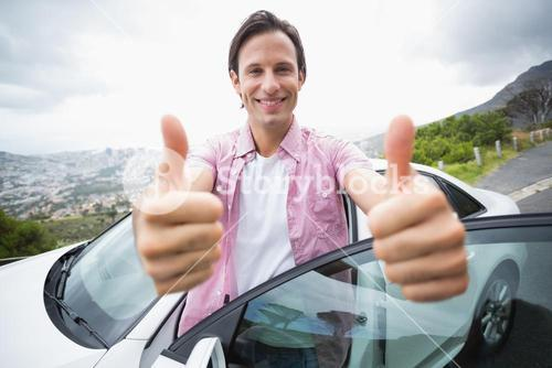 Man smiling at camera with thumbs up