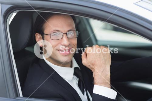 Happy businessman in the drivers seat
