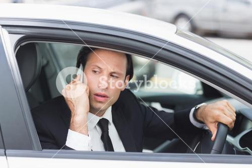 Serious businessman on the phone