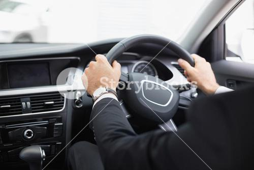 Businessman in the drivers seat