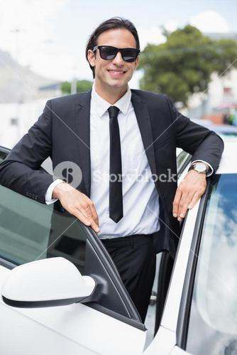 Businessman leaning on the door
