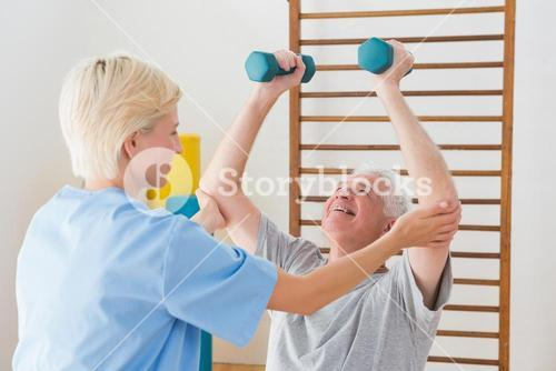 Senior man working out with his therapist