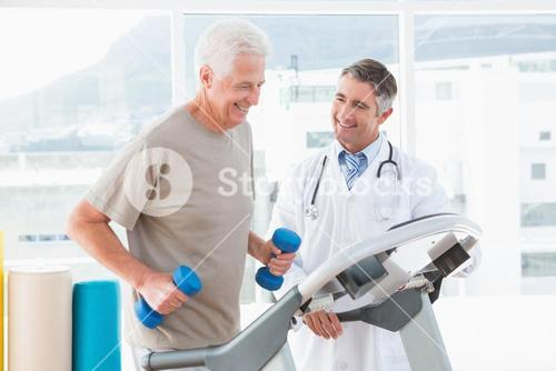 Senior man on treadmill with therapist