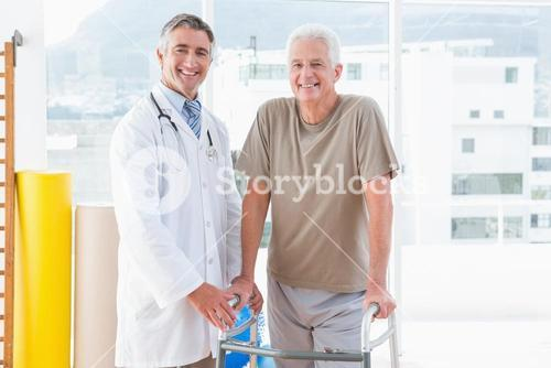 Senior man with therapist smiling at camera