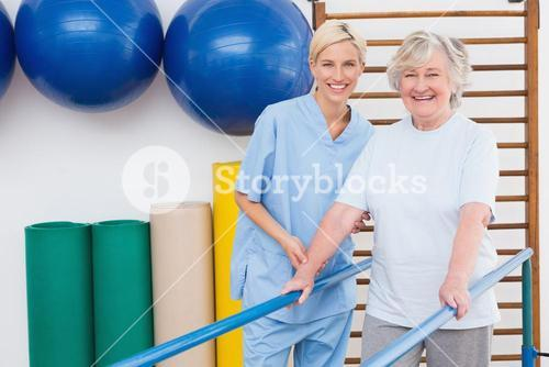 Senior woman and therapist smiling at camera