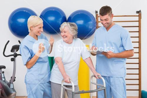 Therapists with invalid senior woman