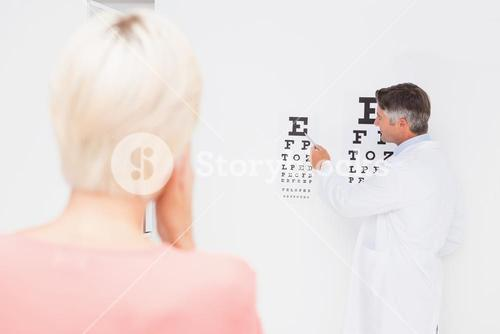 Blonde woman doing eye exam