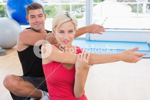 Happy fit couple working